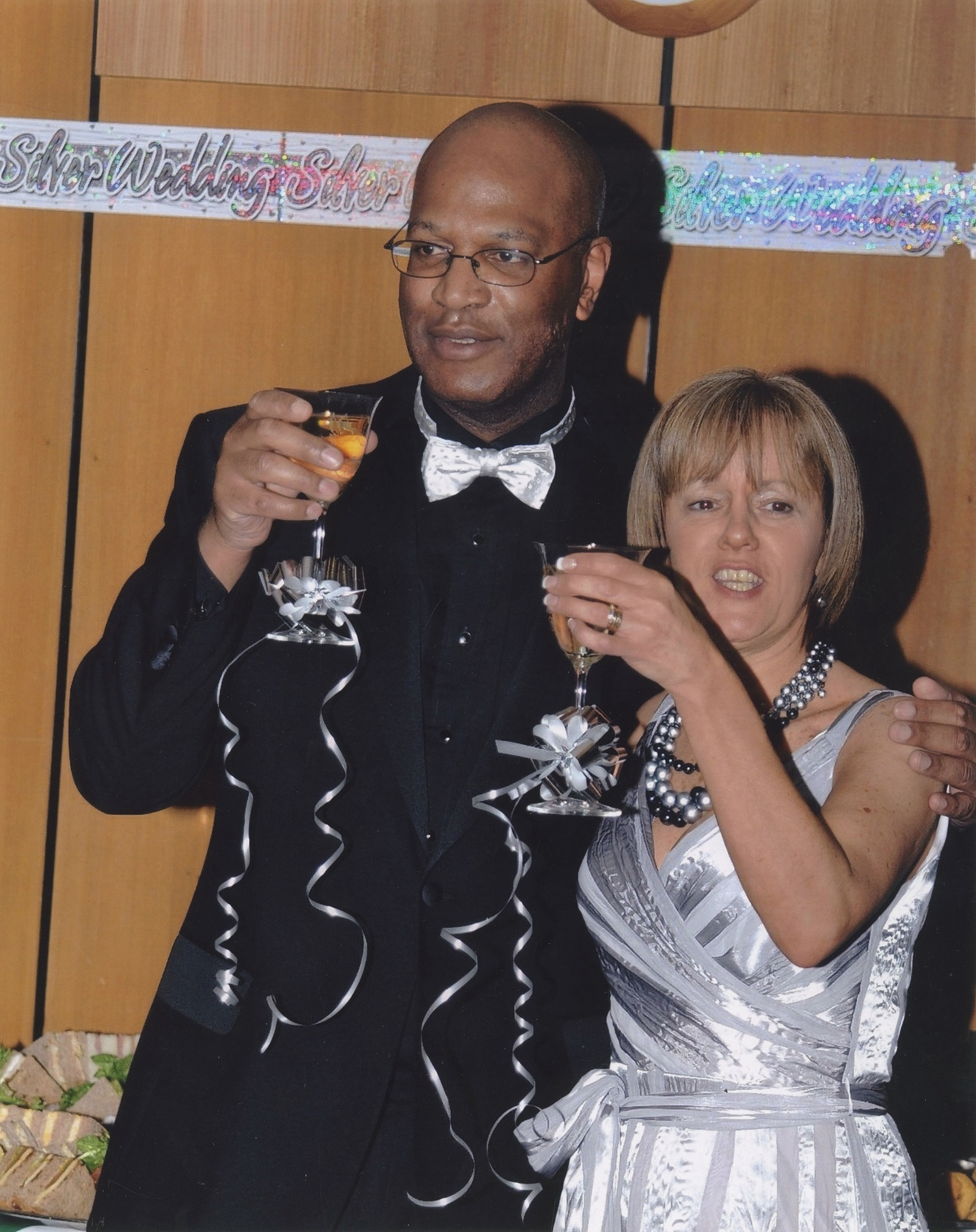 Mixed-race couple of toasting at wedding