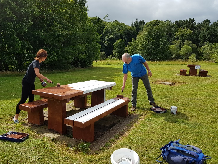 Forth River Trust volunteers painting a bench
