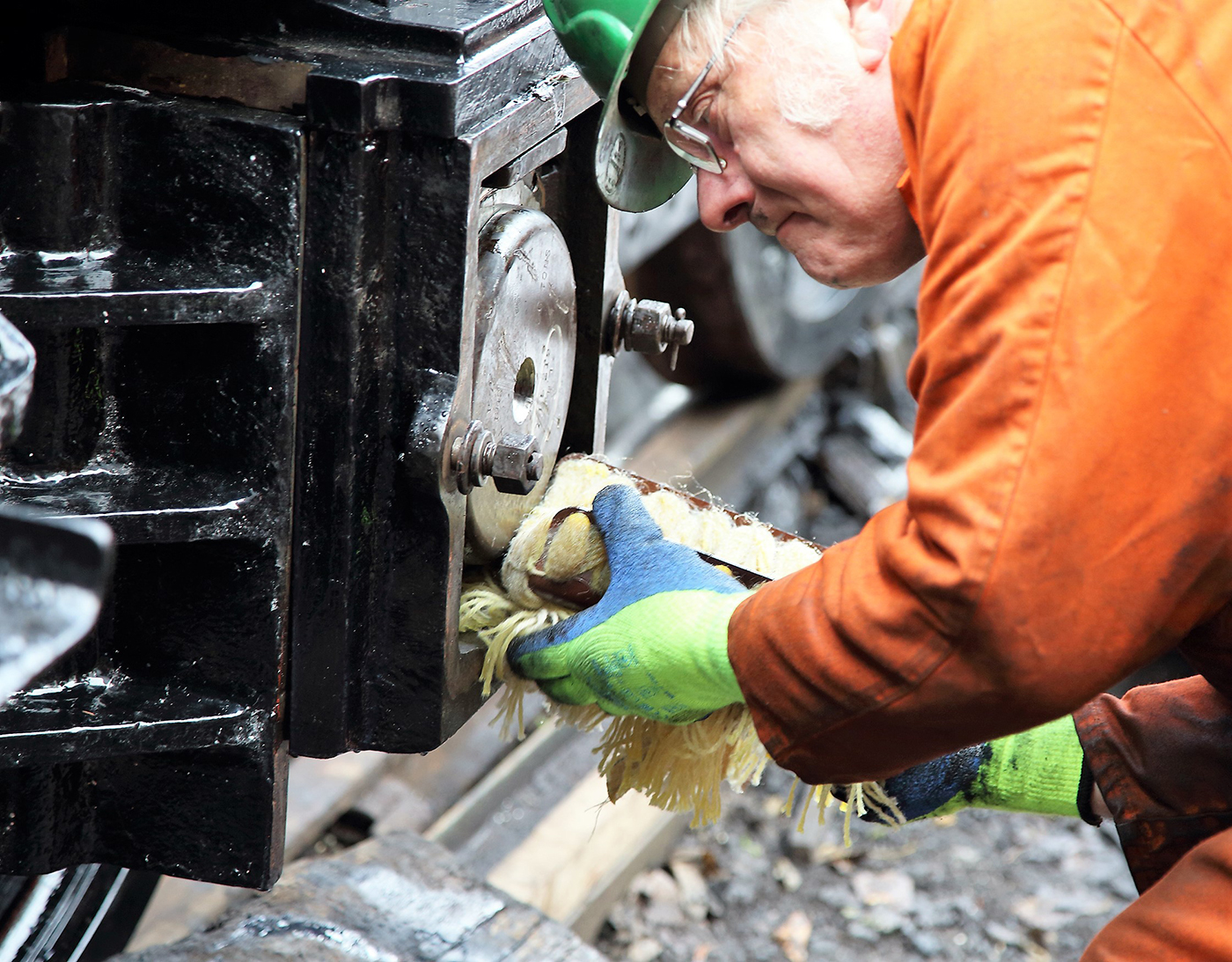 Man working on steam train