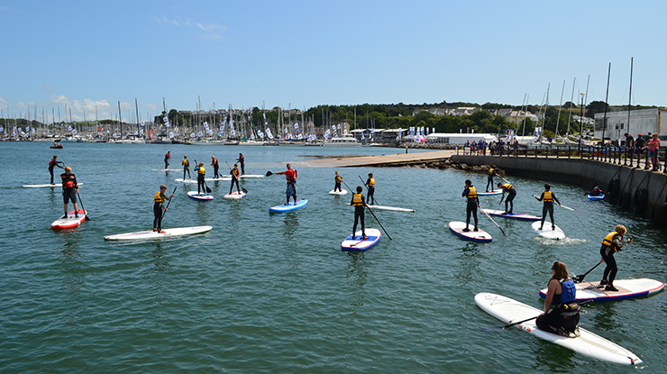 People using paddle boards on the water at Plymouth