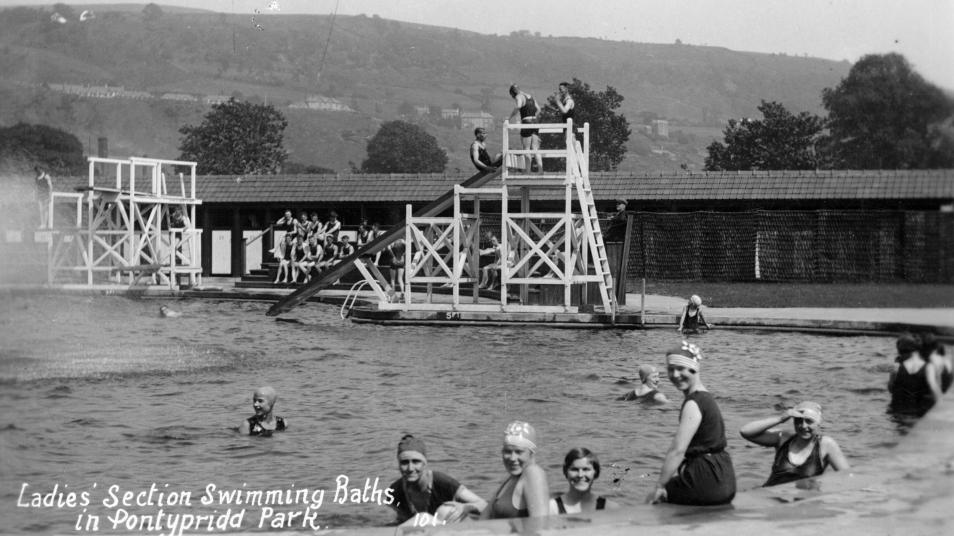 Old photo with text: Ladies' Section Swimming Baths in Pontypridd Park