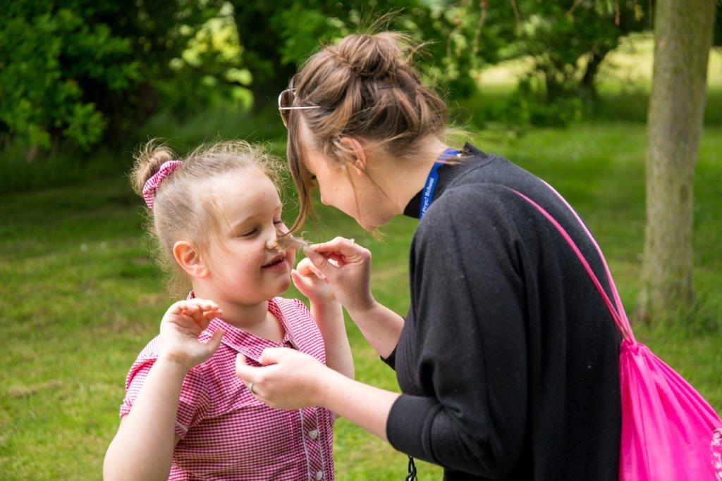 A little girl discovers the outdoors through sensory activities
