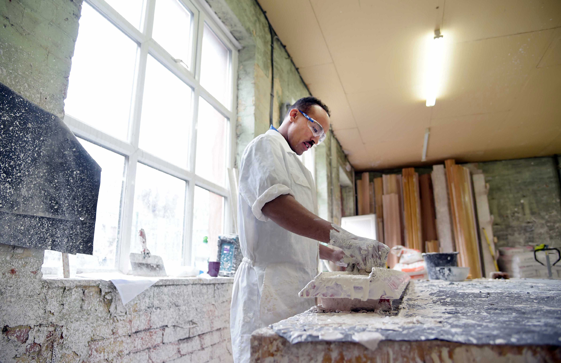 A man works with plaster