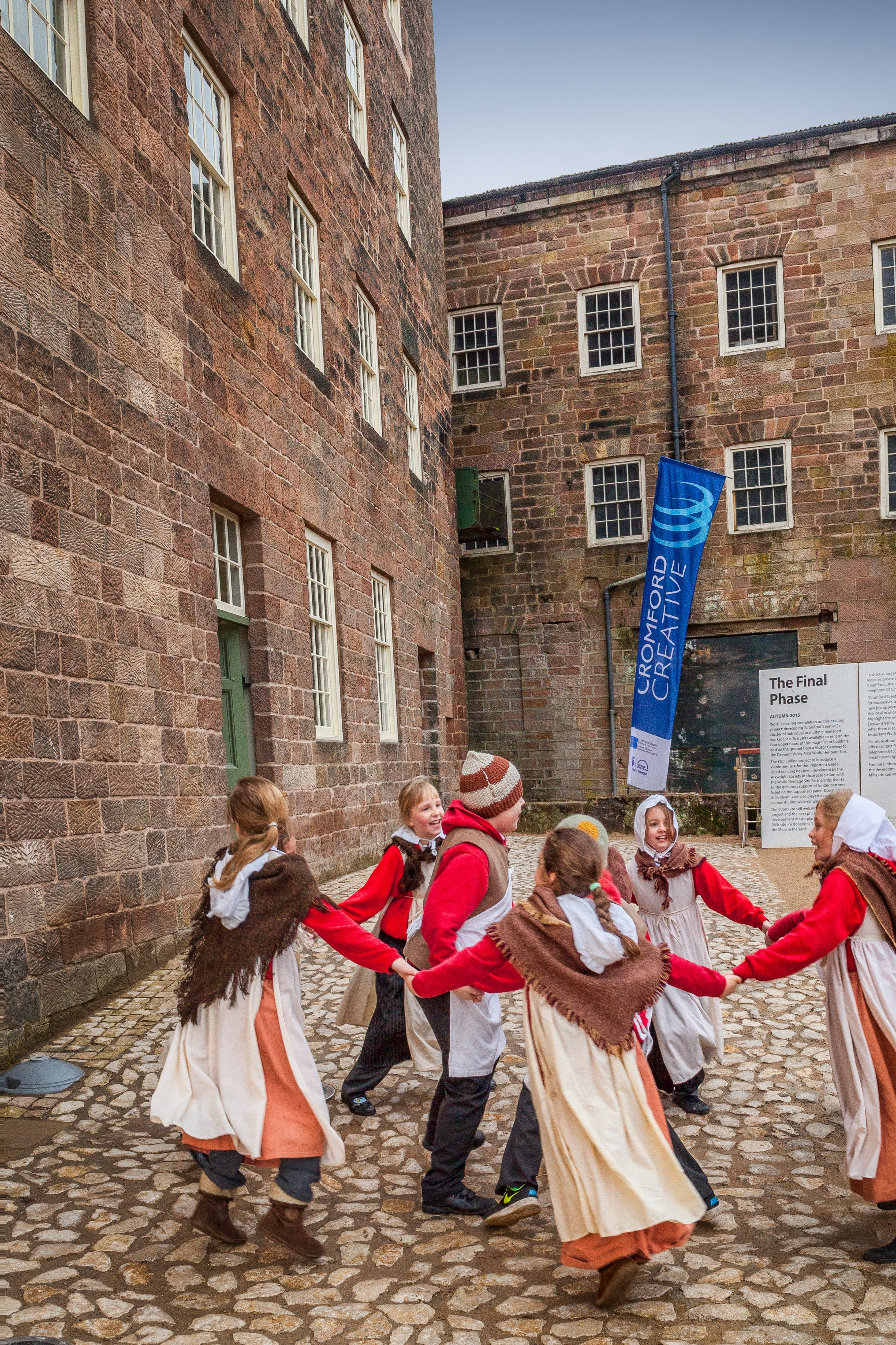 Children dancing at the opening of Cromford Mills