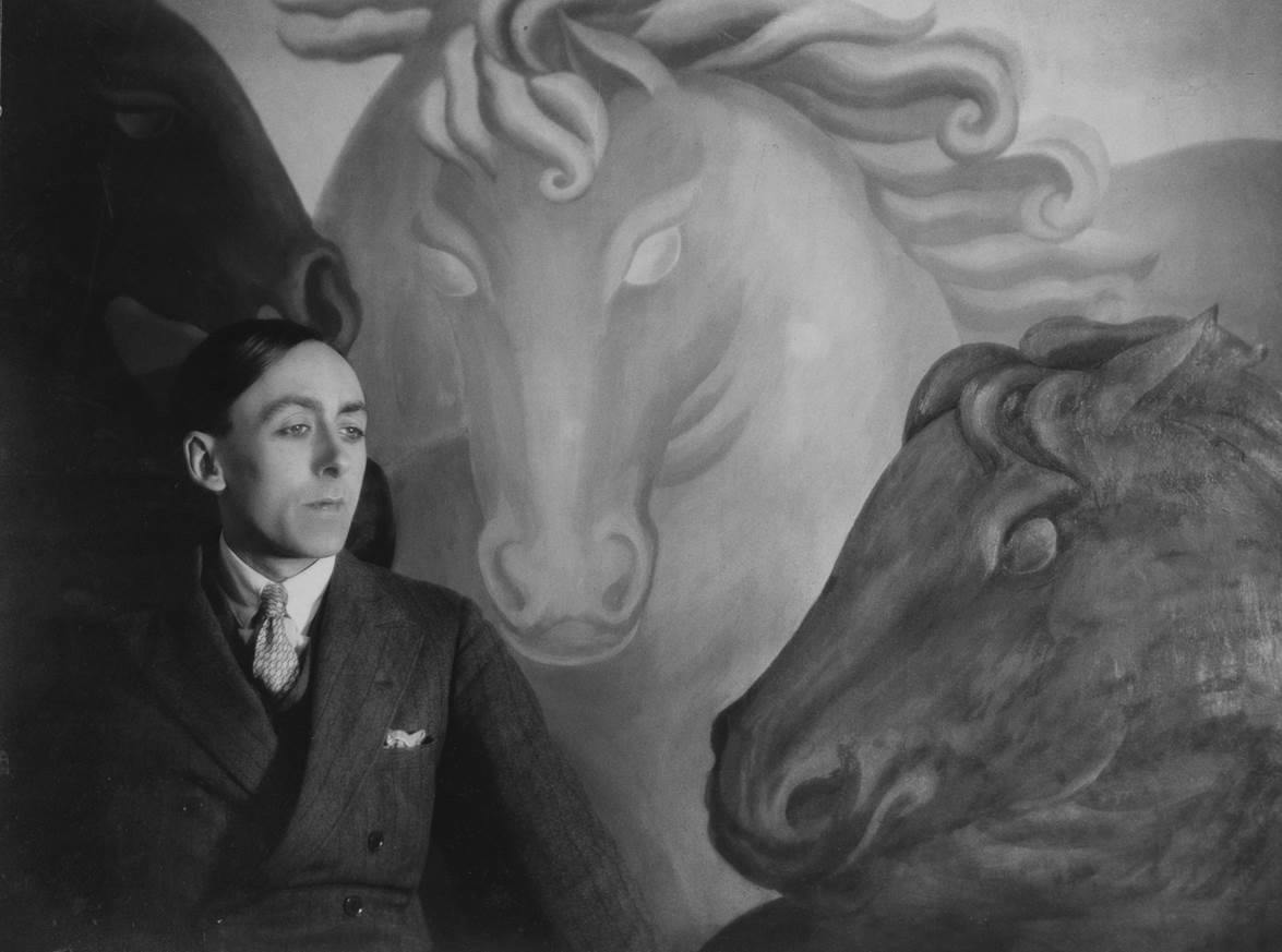 Eddy Sackville-West in front of a painting of horses