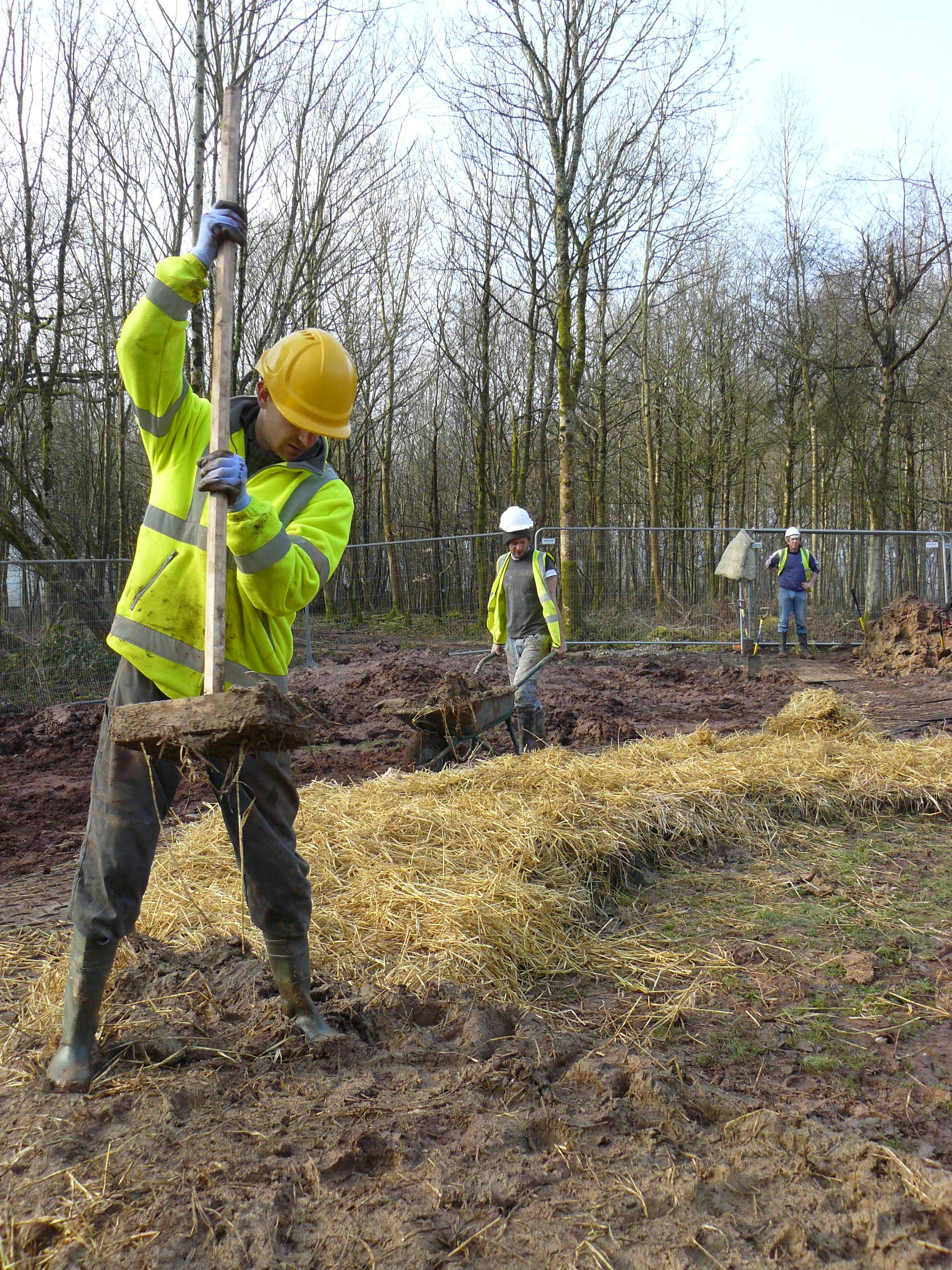A volunteer lays foundations